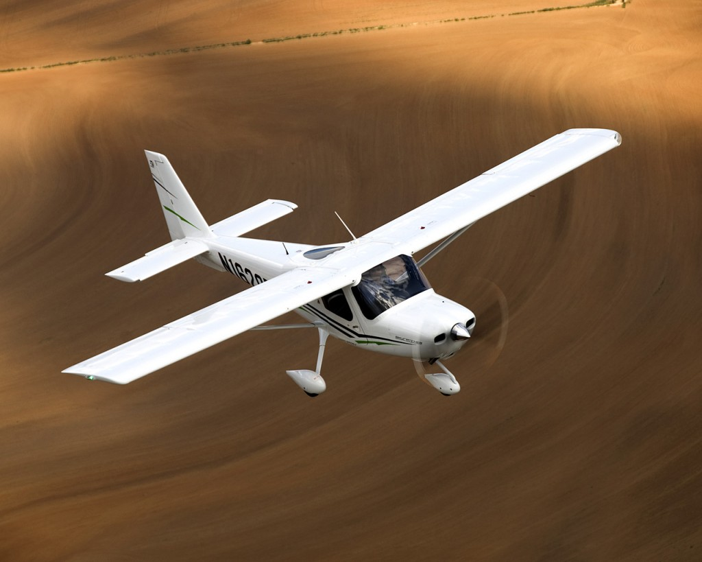 Cessna Skycatcher flying above the desert