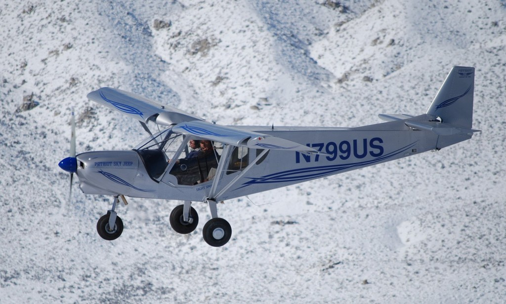 STOL flying above the snow covered ground