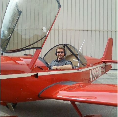 Ray sitting in a plane, ready to take off!